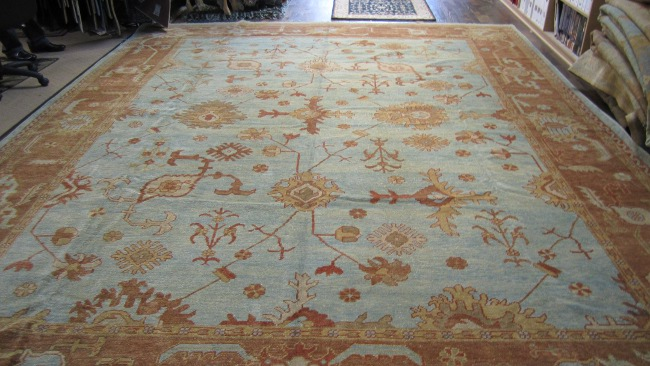 blue and gold oushak rug