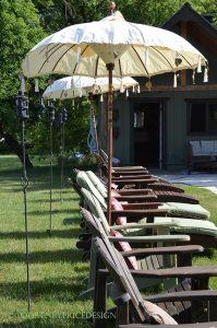 lounge seating, pool seating, tiki torches