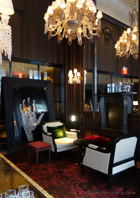 The Petit Salon in The Baccarat Hotel, baccarat chandelier, crystal chandelier, red room, smoked oak panels, stained walls, library room, reading room, small event space new york white upholstery, rope chandelier chains,, crystal sconce, rare baccarat, hotel design, midtown hotel, mid town hotel, hotel near the MOMA, starwood hotel, luxury hotel, luxury new york, cocktails in new york, midtown cocktails, vintage baccarat, baccarat display, rare baccarat , gold ceiling, mica ceiling